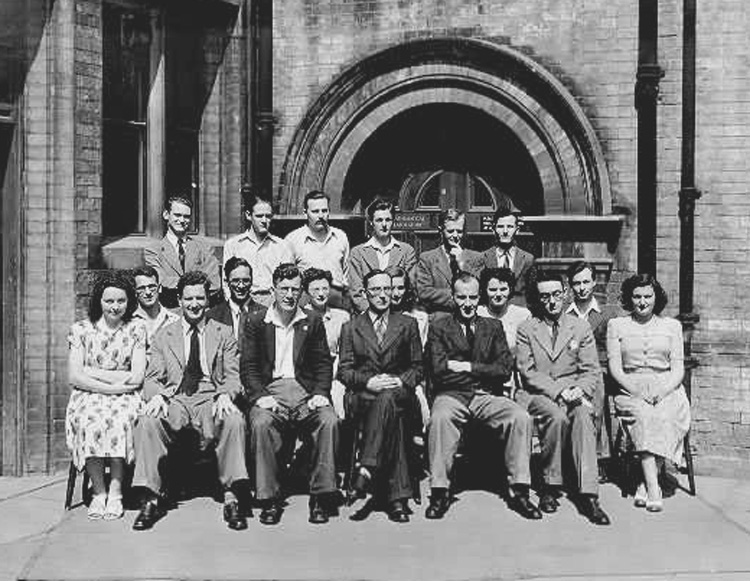 Photograph taken outside the Mathematical Laboratory at Cambridge in 1948.<br />Includes Don Willis (back row - extreme left), Ernest Lenaerts (2nd row - 2nd from left), John Bennett, Eric Mutch, Bill Renwick, Maurice Wilkes (centre front), David Wheeler and Ben Noble (front row - 3rd from left)