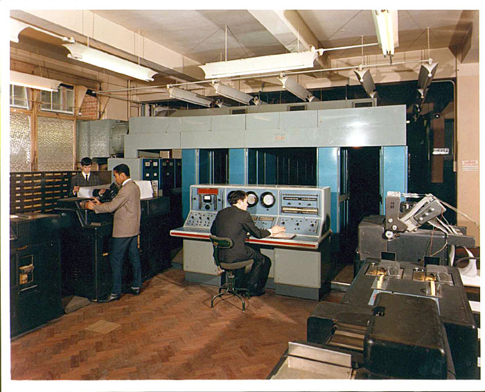 II/I with Stephen Knowles at the console, Peter Taverner behind the printer and Michael ?? checking the printout