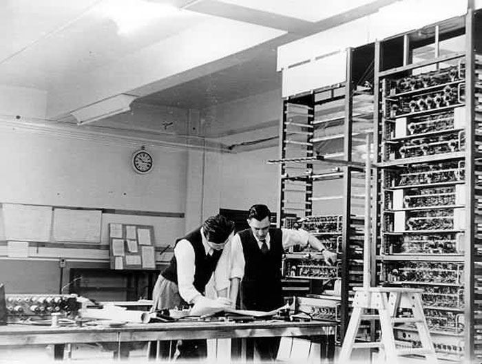 Gordon Gibbs and Ray Shaw  look at a circuit diagram in February 1950.